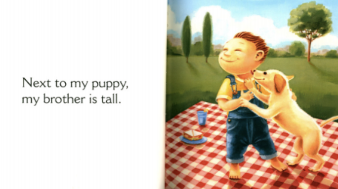 """A boy plays with a puppy. Illustration from """"Next to an Ant."""""""
